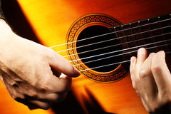 Acoustic guitar playing details Stock Image
