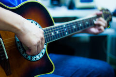 Acoustic Guitar Playing Royalty Free Stock Photography