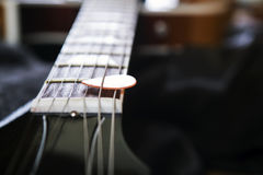 Acoustic guitar with plectrum Stock Photos