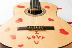Acoustic guitar with red hearts. And i love you text on a white background. Valentines day and love music concept Royalty Free Stock Photos