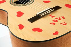 Acoustic guitar with red hearts. And i love you text on a white background. Valentines day and love music concept Royalty Free Stock Image