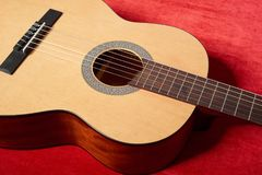 Acoustic Guitar On Red Velvet Fabric Closeup Object Stock Photography
