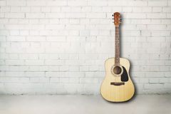 Acoustic guitar in room Royalty Free Stock Photo