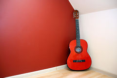 Acoustic guitar in room corner Royalty Free Stock Images