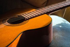 Acoustic guitar in the room, home hobby. Acoustic guitar in the room, home royalty free stock photo