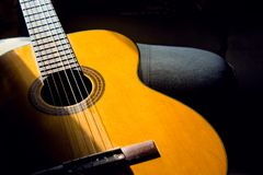Acoustic guitar in the room, home hobby. Acoustic guitar in the room, home royalty free stock photography