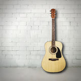 Acoustic guitar in room Royalty Free Stock Photos