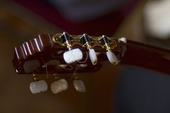 Acoustic guitar's fretboard head Royalty Free Stock Photos