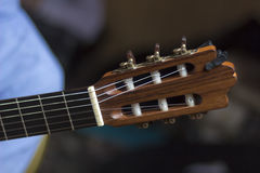 Acoustic guitar's fretboard head Royalty Free Stock Photo