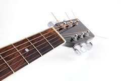 Acoustic guitar's neck. On white royalty free stock photo