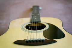 Acoustic guitar. Shallow selective focus stock image