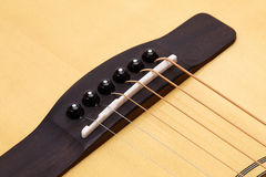 Acoustic guitar showing bridge and strings Royalty Free Stock Images