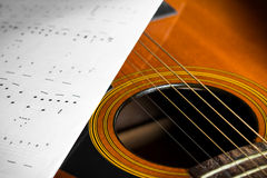Acoustic guitar with song note Royalty Free Stock Photography