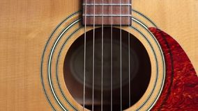 Acoustic Guitar Sound Hole and Pick Panning stock footage