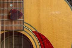 Acoustic Guitar Sound Hole and Pick. Acoustic Guitar Sound Hole, strings and Pick with detail of wood grain Royalty Free Stock Photography