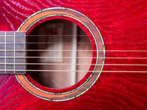 Acoustic guitar sound hole, red wood. Close up shot Royalty Free Stock Photo