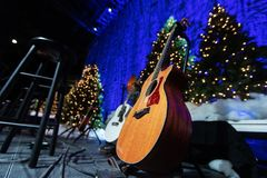Acoustic guitar on stage during Christmas holiday concert royalty free stock photo
