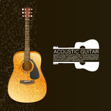 Acoustic guitar standing under beam of light Royalty Free Stock Image