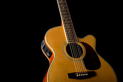Acoustic Guitar. Steel string acoustic guitar in low key photo royalty free stock photo