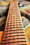 Acoustic guitar, strings and handle detail Royalty Free Stock Photography