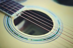 Acoustic guitar strings on wooden table in the room, close up top view and sunlight with empty space for you text. Vintage phto of acoustic guitar strings on royalty free stock photography