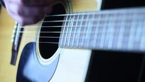 Acoustic guitar strumming Stock Photos