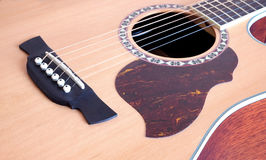 Acoustic guitar top with six strings closeup Stock Photo