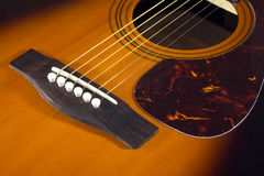 Acoustic guitar top with six strings closeupde Stock Image