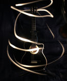 Acoustic guitar under high exposure light Royalty Free Stock Photos