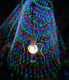 Acoustic guitar under high exposure light Royalty Free Stock Photography