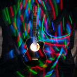 Acoustic guitar under high exposure light Royalty Free Stock Image