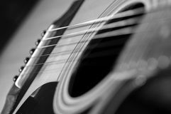 Acoustic Guitar with very shallow depth of field, focus on strings. Black & White Stock Images