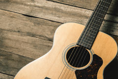 Acoustic guitar. On vintage wooden background royalty free stock photo