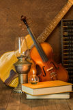 Acoustic guitar,violin,book and abacus Royalty Free Stock Photography