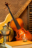 Acoustic guitar,violin,book and abacus Stock Photos