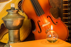Acoustic guitar,violin,book and abacus Stock Images
