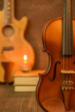 Acoustic guitar,violin,book Stock Photography