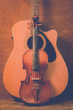 Acoustic guitar and violin Stock Images