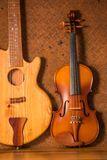 Acoustic guitar and violin Stock Photos