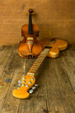 Acoustic guitar, violin Royalty Free Stock Images