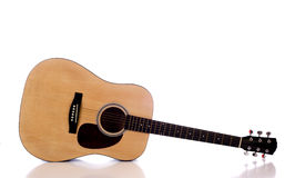 Acoustic Guitar on White. A wooden acoustic guitar on a white background with copy space Stock Images