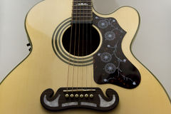 Acoustic guitar. With white background Royalty Free Stock Images