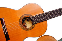 Acoustic guitar on white background. Acoustic guitar close-up isolated on white background Stock Photos