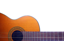 Acoustic guitar on the white background. Classic acoustic guitar at weird and unusual perspective closeup. Six strings free frets sound hole and soundboard Stock Photography