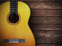 Acoustic guitar on wood background Royalty Free Stock Image