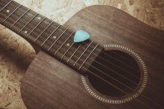 Acoustic guitar. On wood background Stock Photography