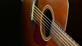Acoustic guitar on wood background. Close up of music instrument Royalty Free Stock Photos