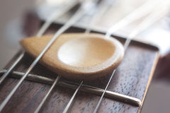 Acoustic guitar and wood plectrum strings macro, soft. Acoustic guitar and wood plectrum strings macro Royalty Free Stock Photos