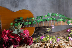 Acoustic guitar on wood table Royalty Free Stock Photography
