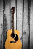 Acoustic guitar on wooden background Stock Image